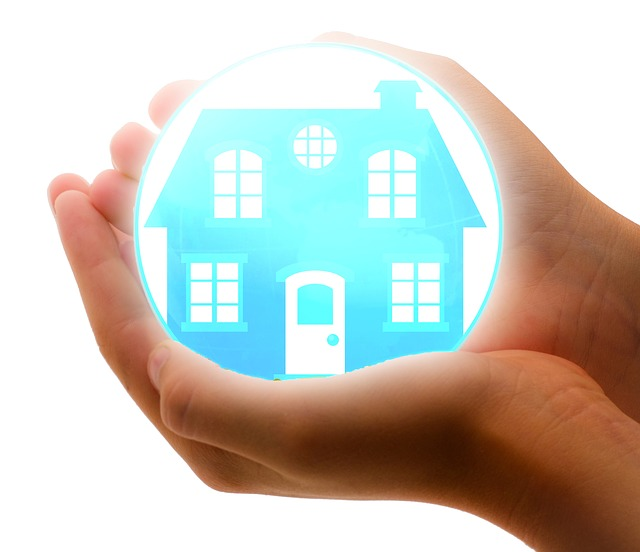 a glowing orb with a picture of a house in it, being held in a person's hands